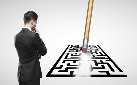 shortcut: businessman looking at pencil with eraser erases maze