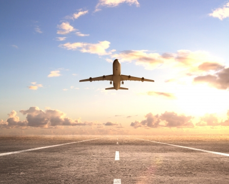 runway: airplane on runway and looking at airplane in blue sky Stock Photo