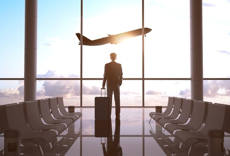 airport business: businessman in airport and airplane in sky