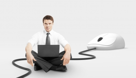businessman sitting with laptop and computer mouse photo