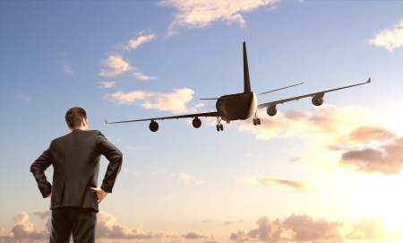 businessman standing and looking on  airplane Stock Photo - 19844164