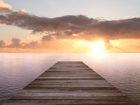 jetée en bois à un coucher de soleil Banque d'images