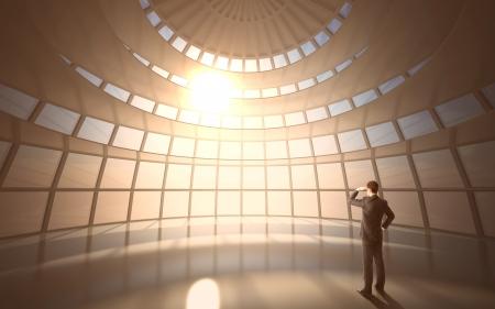 lighting: businessman standing in big office building