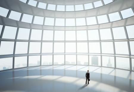 hemispheric: businessman standing in big hall of  hemispheric office building Stock Photo