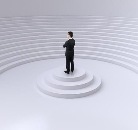 businessman standing: businessman standing on a podium in circle auditorium
