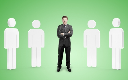 among: businessman among 3d people on green background