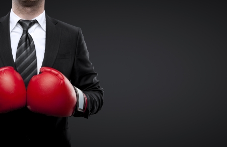red competition: man in boxing gloves isolated on black