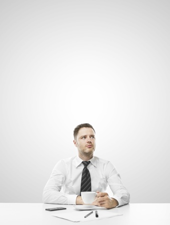 businessman sitting on table and thinking photo
