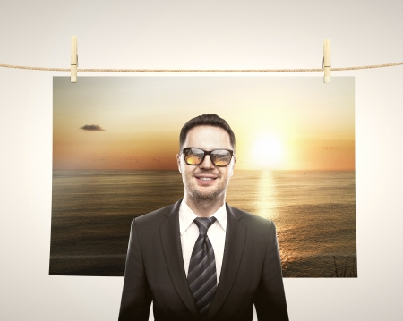 clop: smile businessman and travel poster Stock Photo