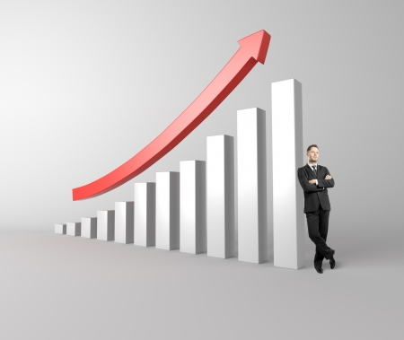 relies: successful businessman relies on the success graph with a red arrow Stock Photo