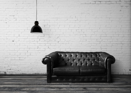 brick room with leather sofa Stock Photo