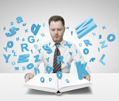 businessman holding book with many letters Stock Photo - 20339987