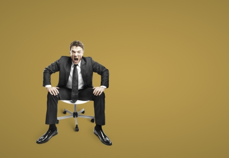sobbing: businessman sitting on chair and screaming Stock Photo