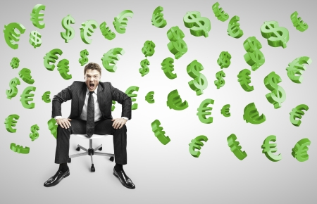 businessman sitting on chair and screaming with falling dollars and euros Stock Photo - 20280670