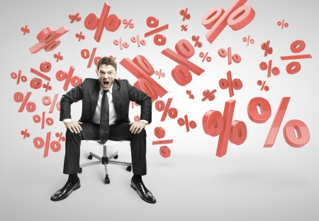 man sitting on chair and screaming with falling procents Stock Photo - 20280638