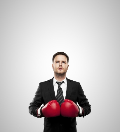 boxing equipment: businessman in boxing gloves isolated on white