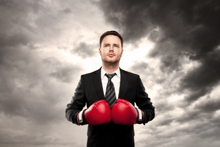 businessman in boxing gloves on cloud background Stock Photo - 20339990