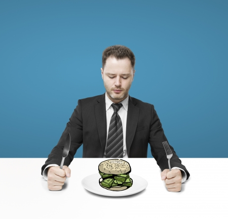 businessman sitting and eating hamburger money photo