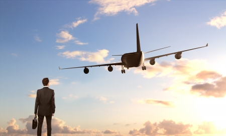 businessman standing and looking on  airplane Stock Photo