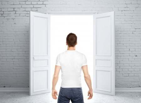 man standing back and opened door photo