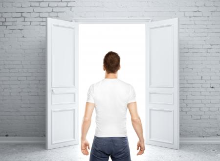 front room: man standing back and opened door