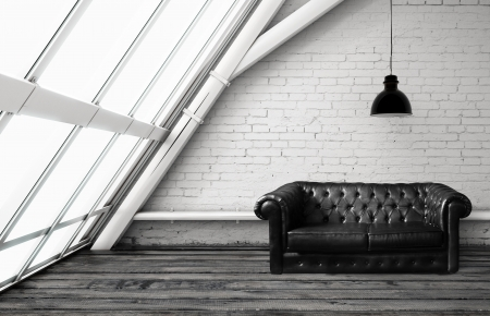 old sofa: loft with window and leather sofa Stock Photo