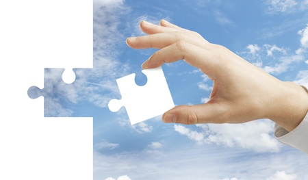 hand collect puzzle on sky background Stock Photo - 20416871