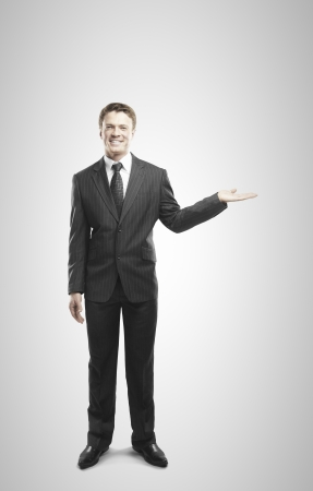 businessman holding something  on a white background Stock Photo - 20523203