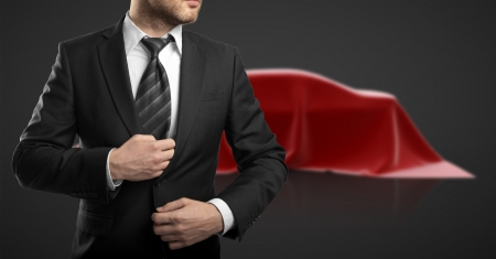 mystery man: businessman in suit and car presentation