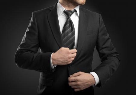 D'affaires en costume sur fond noir Banque d'images - 20523201