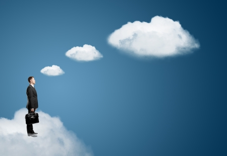 businessman on cloud with briefcase photo