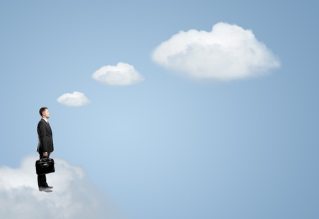 man on cloud with briefcase photo