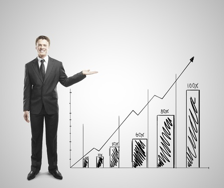 young businessman standing and shows arrow graph photo