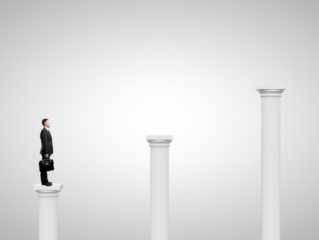 businessman  standing on a column Stock Photo - 20523136