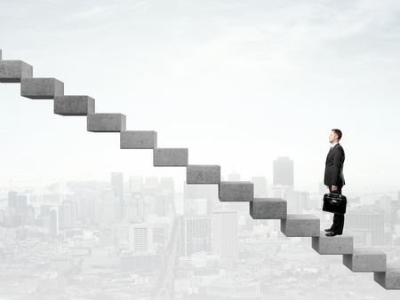 difficult journey: Businessman standing a staircase and city