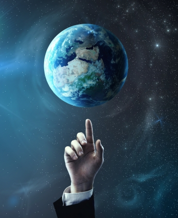 world peace: hand pointing at earth, space concept Stock Photo