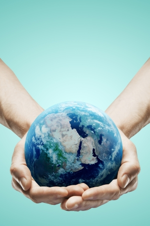 earth hands: hands holding earth on white background