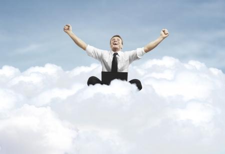 businessman laptop: businessman admiring his success in cloud Stock Photo