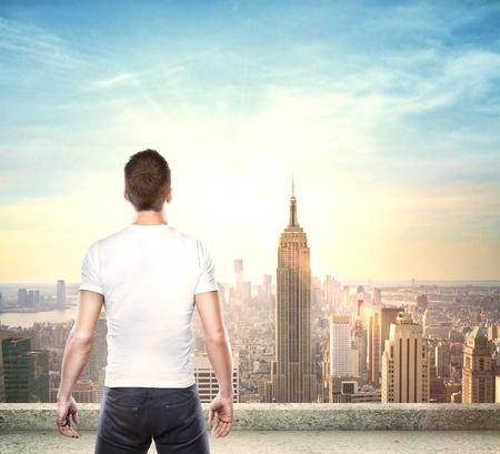gay boy: boy looking at modern city Stock Photo