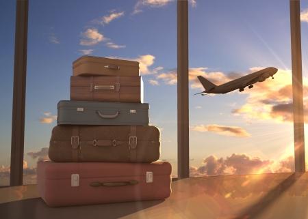 viajes: bolsas de viaje y el avión en el cielo