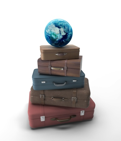 travel bags and earth  on a white background photo