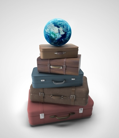 travel bags and earth  on a gray background photo