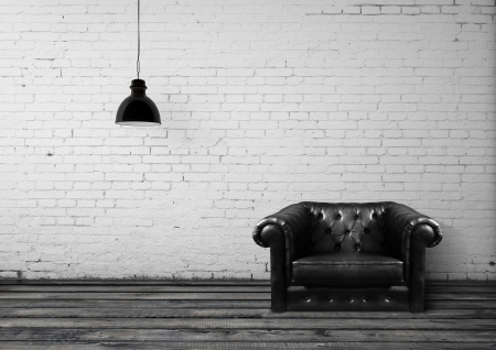 white leather: brick room with leather chair Stock Photo