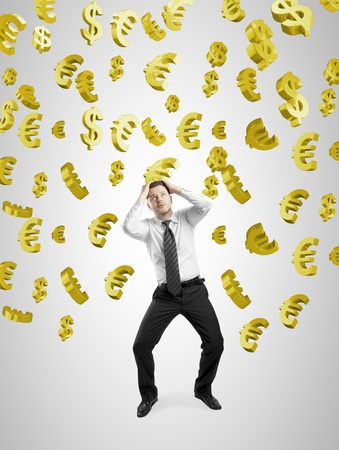 businessman concealed his hands from falling  gold dollar and euro signs Stock Photo - 20523745