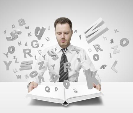 intellect: businessman holding libro con molte lettere Archivio Fotografico