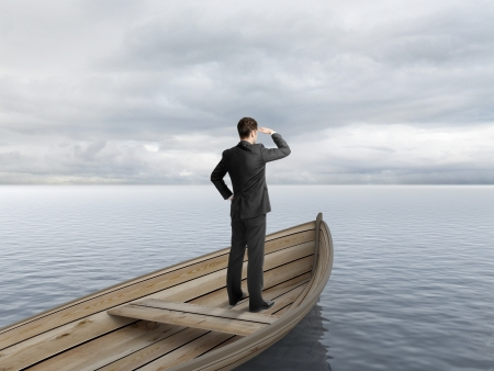 businessman standing on a boat and looking on ocean Stock Photo - 20523272