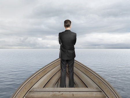 businessman standing on a boat and looking on sky Stock Photo - 20523377