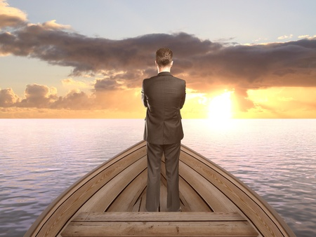 businessman standing on a boat and looking on sunset Stock Photo - 20523418