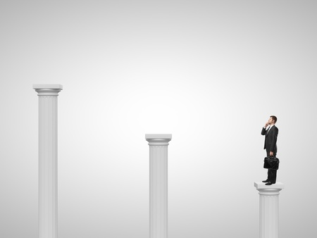 man standing on a column and talking on phone photo