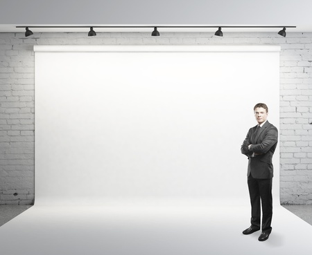 businessman standing: young businessman standing on studio Stock Photo